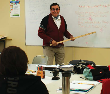 "PASSIONATE ABOUT TEACHING. Louis Soop engages students in a Blackfoot language class. Soop always starts with the basics, noting, ""You can't use big words with 20 letters."" Photo by Neal Shade"