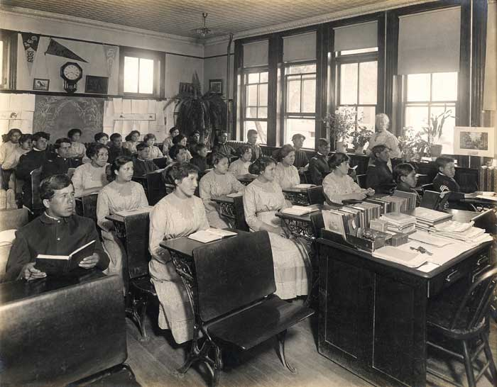 1911 PHOTOGRAPH OF A TYPICAL CLASS AT THE GENOA INDIAN SCHOOL